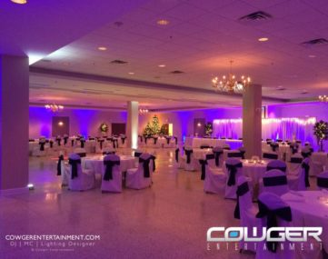 wide view colorfully lit wedding reception