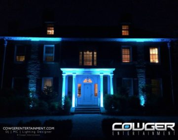 lit up colums, portico, and walls of front exterior