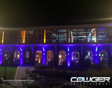 outside of reception hall with colorful exterior lighting
